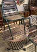A circular slatted wood and wrought iron garden table, 85cm diameter, height 78cm together with a