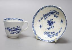 An 18th century Worcester 'feather mould floral' coffee cup and saucer, workman's marks, diameter