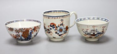 An 18th century Liverpool coffee cup and two teabowls, painted in blue with overglaze red
