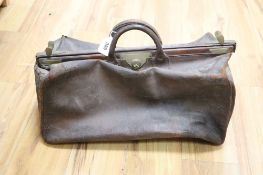 A leather Gladstone bag