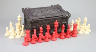 """A Jaques London red and white ivory 3 1/2"""" Staunton chess set, c.1850, with Carton Pierre casket,"""