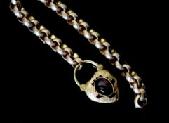 A Victorian facetted gold link bracelet, with associated? engraved gold and cabochon garnet set