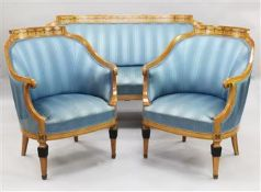 A Biedermeier satin birch three piece suite, with bell flower inlay, upholstered in blue stripe silk