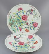 A pair of large Chinese famille rose dishes, late 19th century, each painted with peonies and