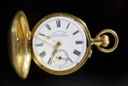 An early 20th century Swiss engine turned 18k gold hunter keyless fob watch, retailed by Courvoisier