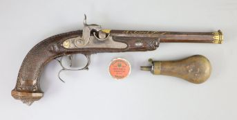 A late 18th/ early 19th century French gold inlaid pistol by Henraux with finely carved walnut