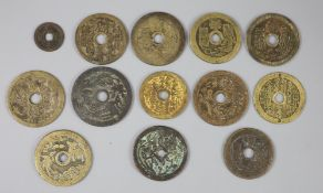 China, 12 cast bronze charms or amulets, Qing dynasty, seven inscribed 'Tai Shang zhou yue..',
