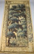 A 17th century Flemish verdure tapestry wall hanging, with central panel of trees withing flower and