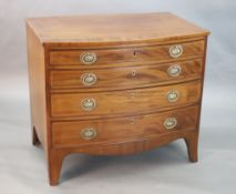 A Regency crossbanded mahogany bowfront chest, of four graduated long drawers, on swept bracket