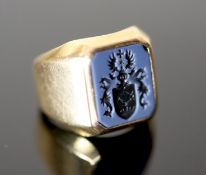 A mid 20th century continental 18ct gold and blue sardonyx set signet ring, the matrix carved with