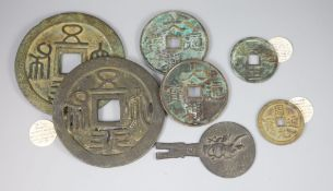 A group of 7 Chinese bronze coin charms or amulets, Qing dynasty- Republic period, to include a