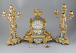 A 19th century Louis XVI style ormolu and Sevres style porcelain clock garniture, the mantel clock