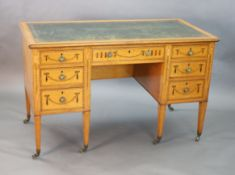 An Edwardian Edwards & Roberts marquetry inlaid satinwood kneehole desk, with tooled green skiver
