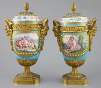 A pair of French Sevres style porcelain and ormolu mounted vases and covers, 19th century, each