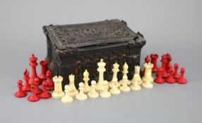 """A Jaques London red and white ivory 2¾"""" Staunton chess set, c.1850, with original Carton Pierre"""