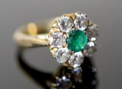 A 20th century gold, emerald and diamond set circular eight stone cluster ring, size H, gross 5.1