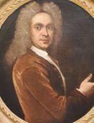 School of Sir Godfrey Kneller (1646-1723)oil on canvasPortrait of a gentleman holding a set of