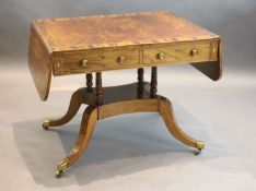 A Regency mahogany sofa table banded in coromandel, with d shaped flaps and two frieze drawers, on