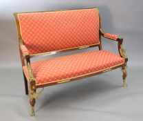 A late 19th century French Empire style ormolu mounted mahogany three piece salon suite,