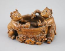 A fine and rare Chinese bamboo-root 'boys and fish bowl' brush washer, 18th/19th century, carved