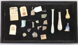 A group of three Roman glass vessels and Egyptian/Roman glass fragments, many with old collection