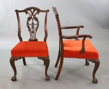 A set of eight Chippendale Revival mahogany dining chairs, including a pair of carvers, with