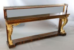 A pair of William IV parcel gilt rosewood console tables, with pierced brass anthemion galleries,