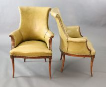 A pair of Regency style leather and mahogany library chairs, with brass studded olive green