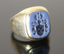 An early-mid 20th century 14ct gold and blue sardonyx set signet ring, the matrix carved with ornate