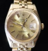 A gentlemans 1990's? 18k gold Rolex Oyster Perpetual Datejust wrist watch, on a 18k gold Rolex