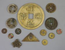 China, a group of 14 bronze and brass coin charms or amulets, Qing to Republic period, F to VF to