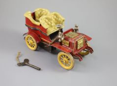A Bing clockwork tinplate car, c.1906, with cream painted seats, red bodywork and yellow wheels,