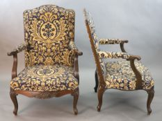 A pair of Louis XVI style mahogany fauteuils, with gadroon and floral scroll carved frames, later