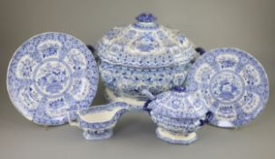 An extensive Minton filigree pattern blue and white dinner service, c.1830, including a soup tureen,