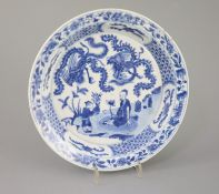 A Chinese blue and white 'sage and phoenix' dish, Kangxi period, painted with the seated figure of a