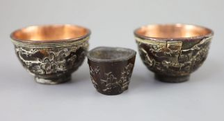 A pair of Chinese coconut 'landscape' cups and a similar peach-shaped cup, 18th/19th century, the