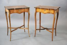 A pair of Louis XVI style ormolu mounted marquetry work tables, with serpentine rectangular tops, on