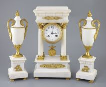 A Louis XVI style ormolu mounted white marble clock garniture, with Portico clock flanked by a