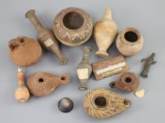 A group of Ancient Roman pottery vessels and a bronze statuette of Venus, mostly 1st-4th century AD,