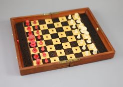 A Jaques & Son Ltd In Statu Quo bone travelling chess set, in mahogany case, c.1860, with brass
