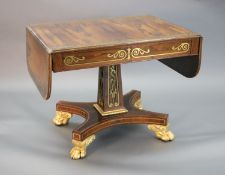 A Regency brass inset rosewood sofa table, the top with D shaped flaps inlaid with a band of