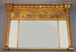 A Regency style giltwood and composite overmantel mirror, late 19th century, decorated with lion