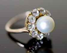 A modern gold, cultured pearl and diamond set circular cluster ring, size M, gross 4.7 grams.