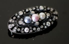 An early 20th century gold and silver, diamond and three colour split pearl set oval openwork