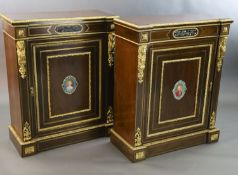A pair of 19th century French ormolu mounted walnut pier cabinets, inset with pietra dura and