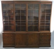 A George III mahogany breakfront library bookcase, with moulded cornice and four astragal glazed