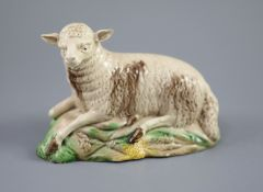 A Ralph Wood the Younger polychrome pottery figure of a recumbent ewe, c.1780-90 , length