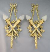 A pair of early 20th century Louis XVI style ormolu wall lights, with ribbon and oak branch backs,