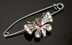 An Edwardian gold and silver, rose cut diamond, white opal and ruby set butterfly brooch, width