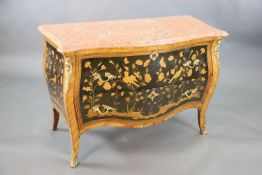 A French Louis XV style kingwood and ormolu mounted serpentine bombe commode, with veined pink